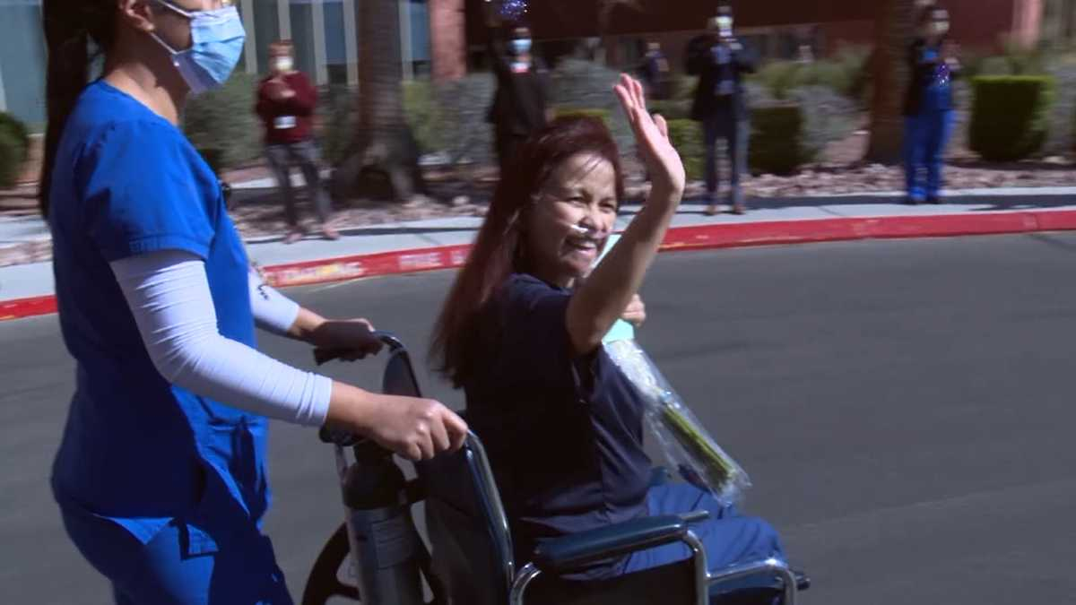 A nurse who nearly passed away from coronavirus receives cheers from medical facility personnel as she's being released