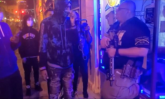BLM protesters confront gun-toting storeowner in Louisville as they press him to voice his support