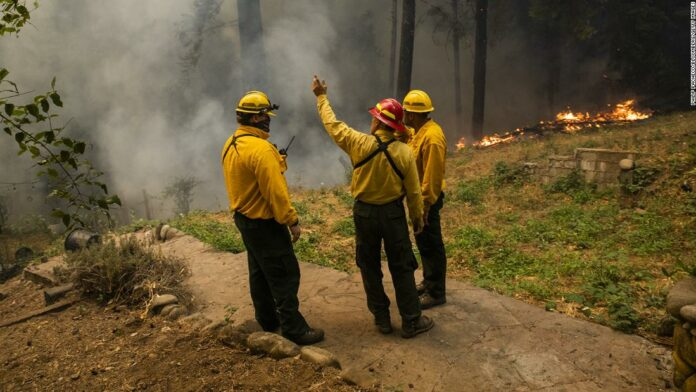 Oregon authorities battle conspiracy theories as firefighters fight the flames