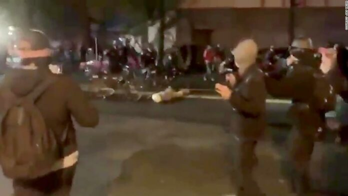 Seattle police officer captured on video riding his bicycle over a protester's head placed on leave