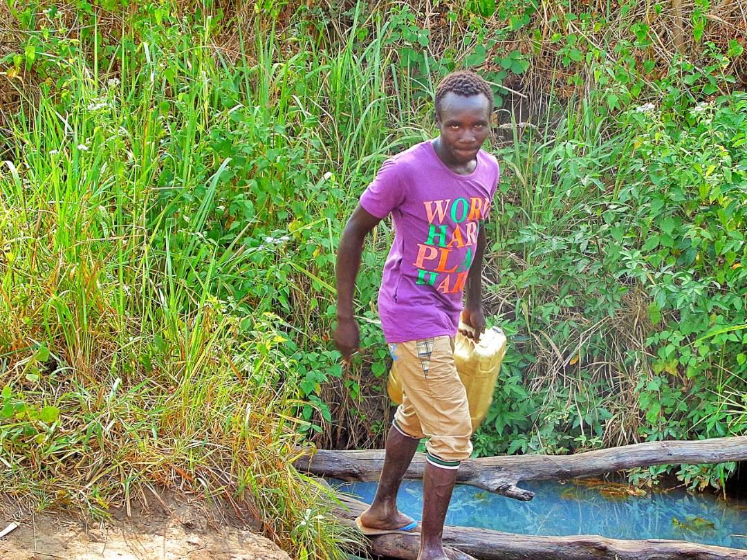Boy carrying water
