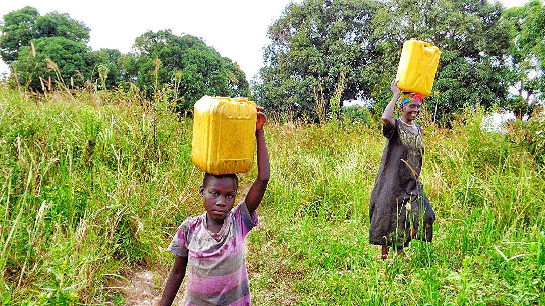 Youth carrying water from the Stream