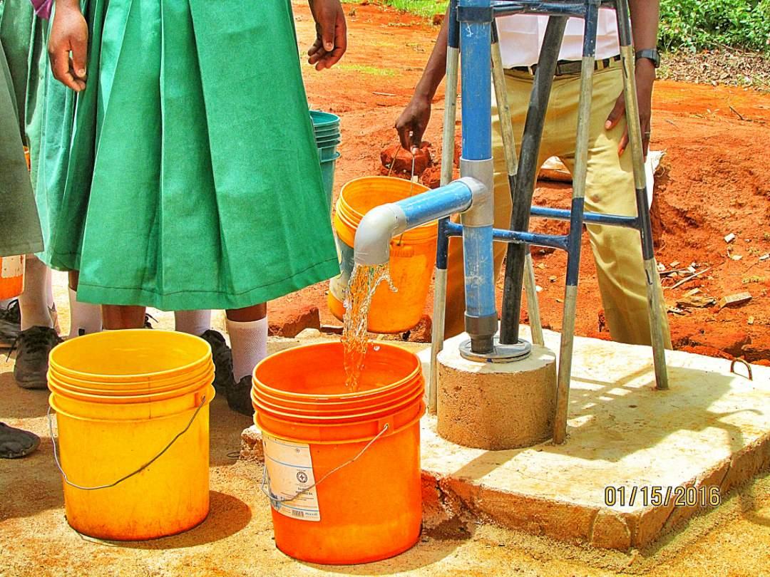 Girls Filling Water Buckets
