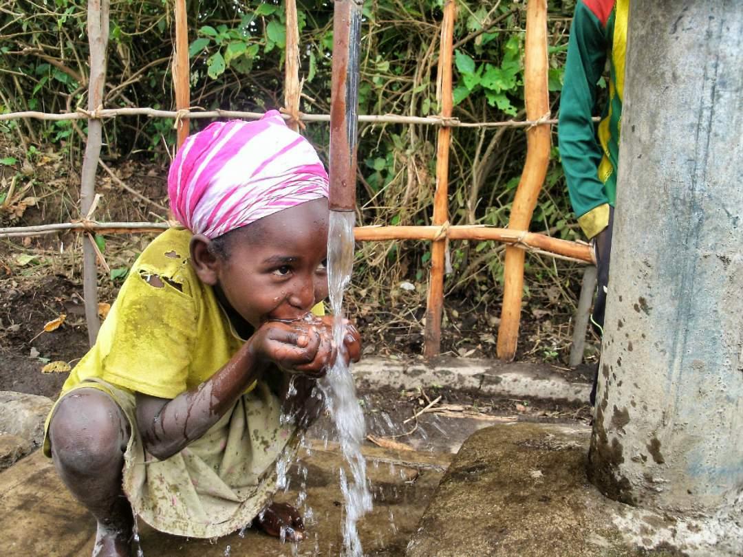 Child drinking fresh water