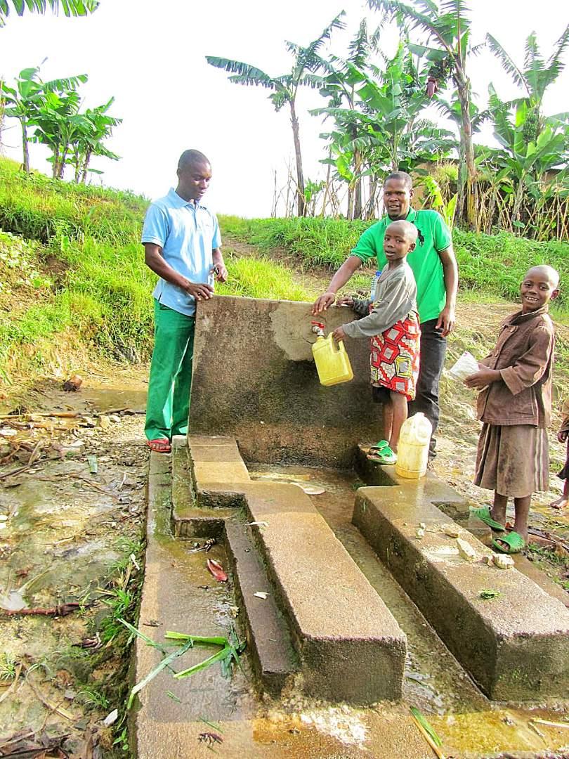 Happy children fetching water