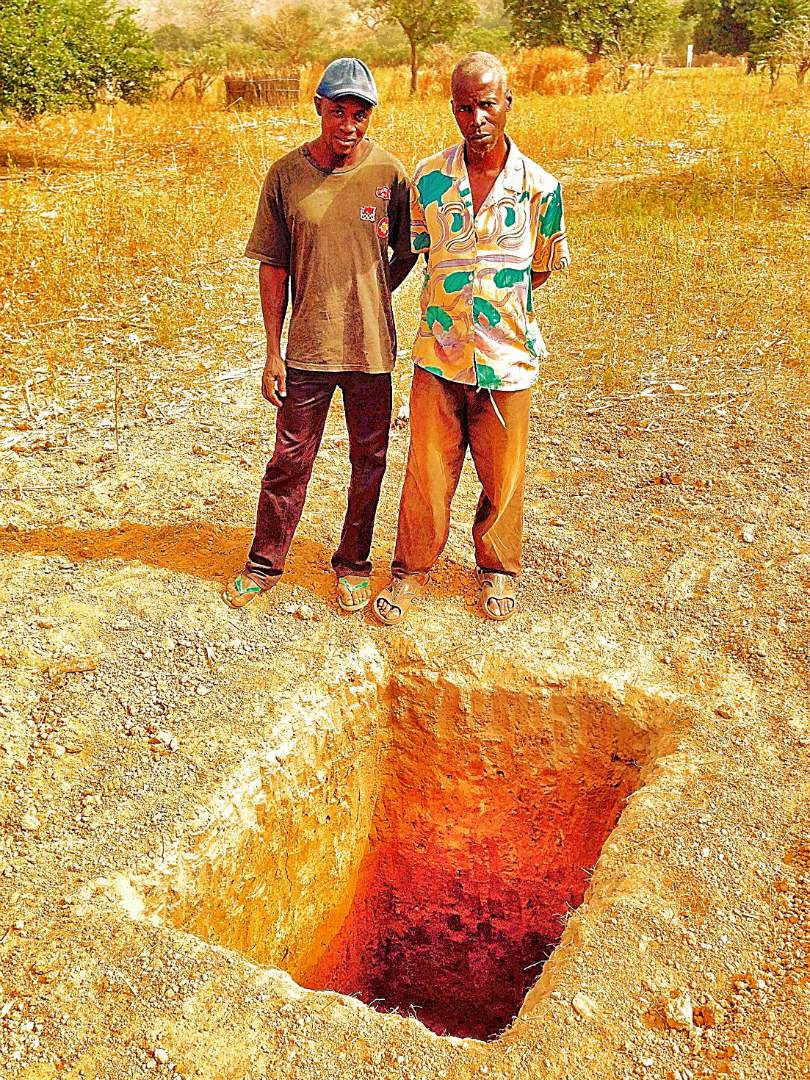 Digging a pit for the latrine
