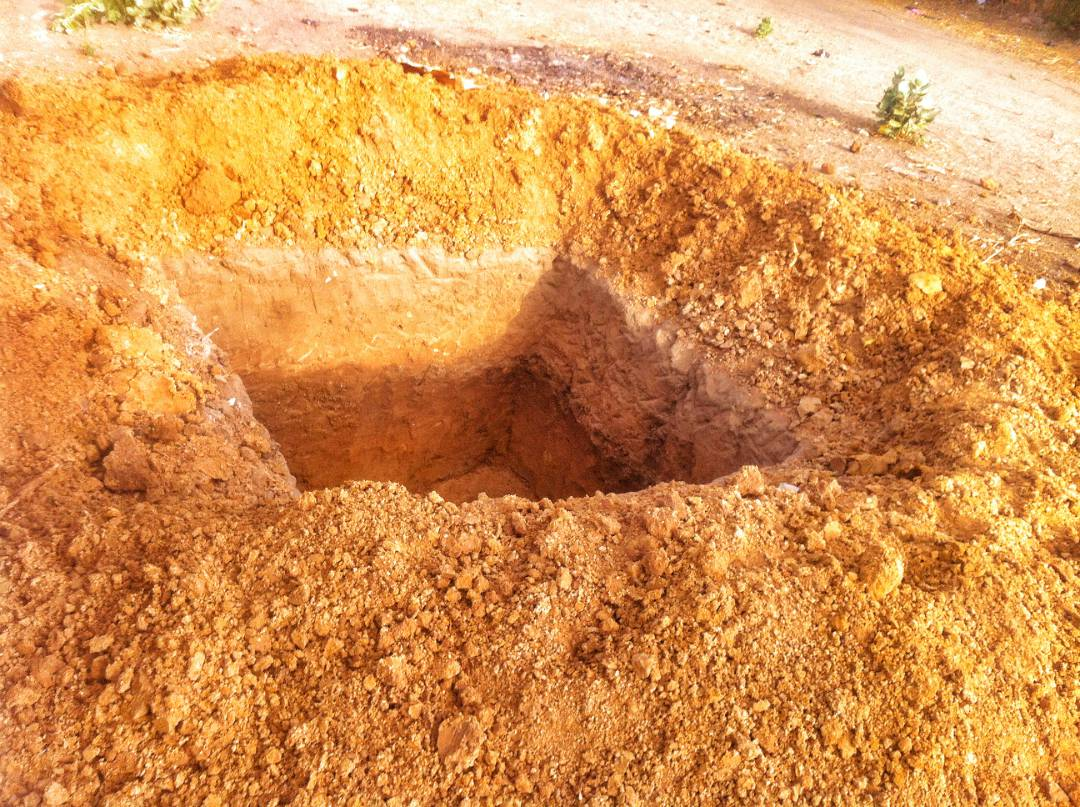 Digging the pit for the latrine