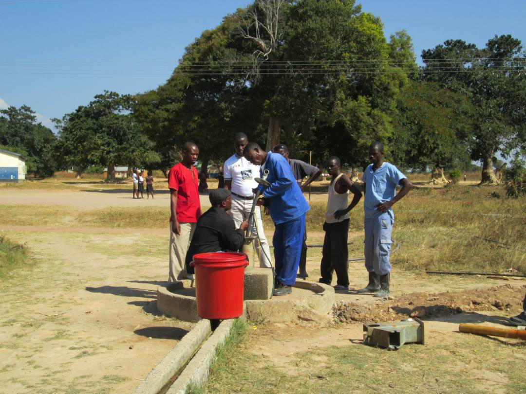 Community health workers and clinic staff at Mibenge receive instruction from Municipal Council about minor repairs