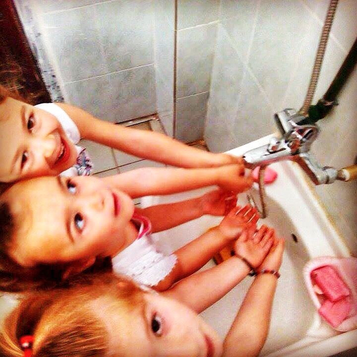 Super cute kids playing with new sink