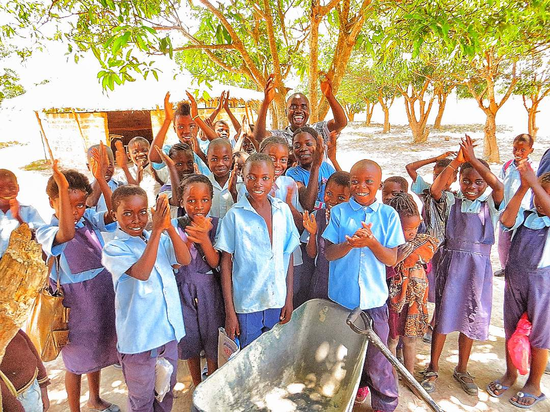 Students celebrating the new well