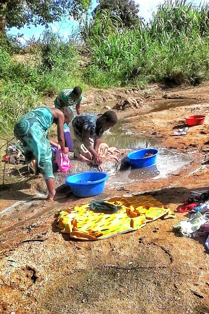 washing clothes at the water source