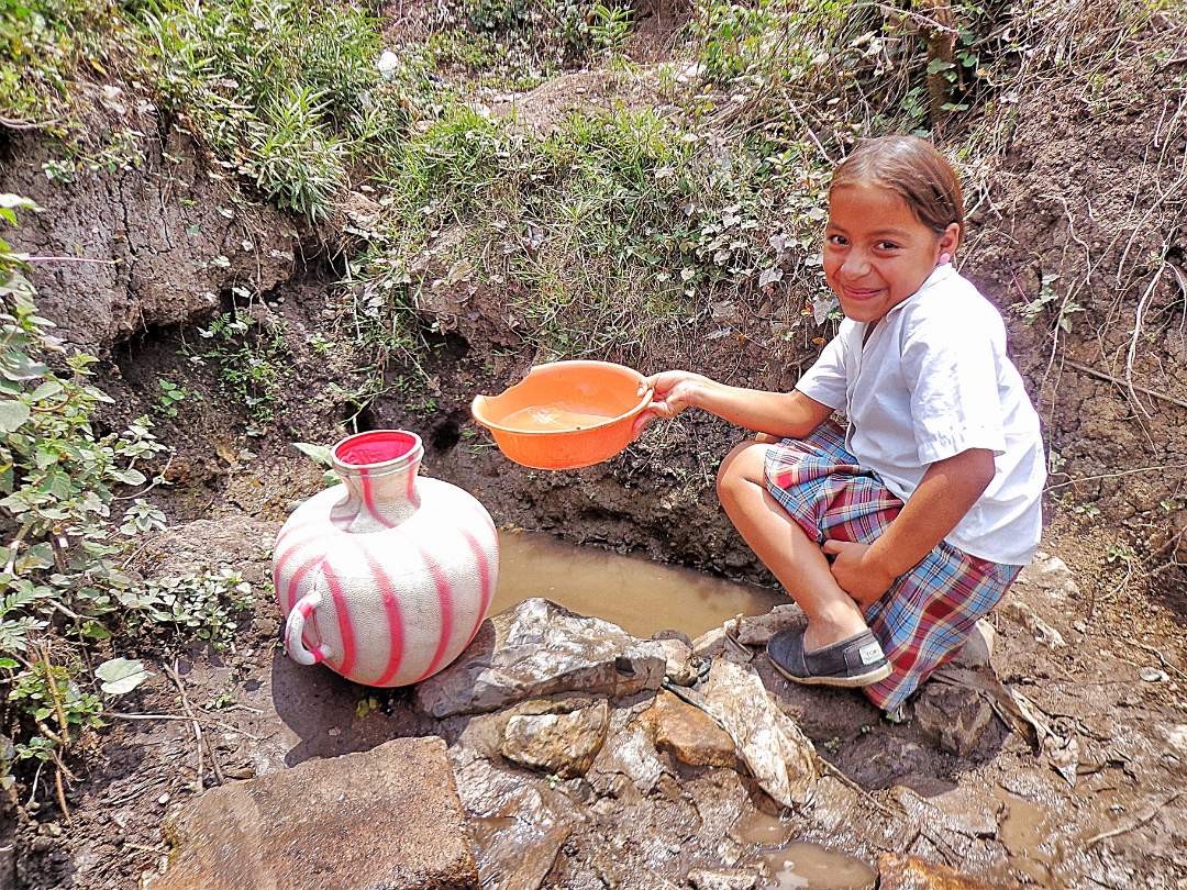 Young girl getting water