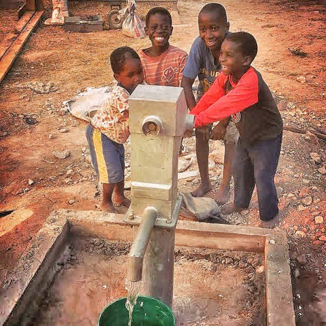 Youth at the water pump