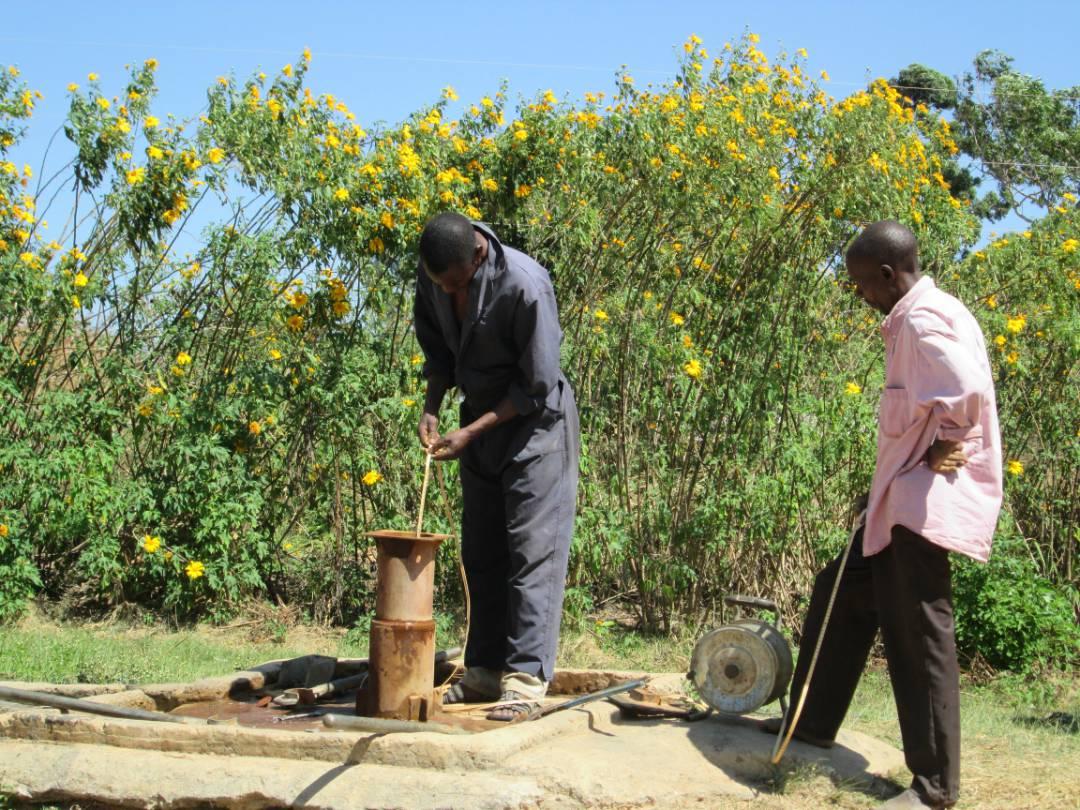 Measuring the depth of the borehole at Manutumbusa