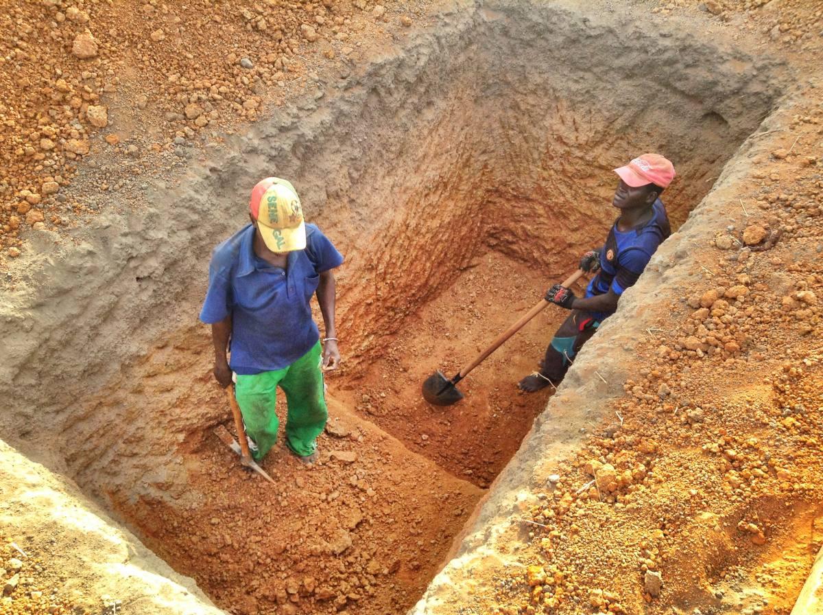 Digging the latrine