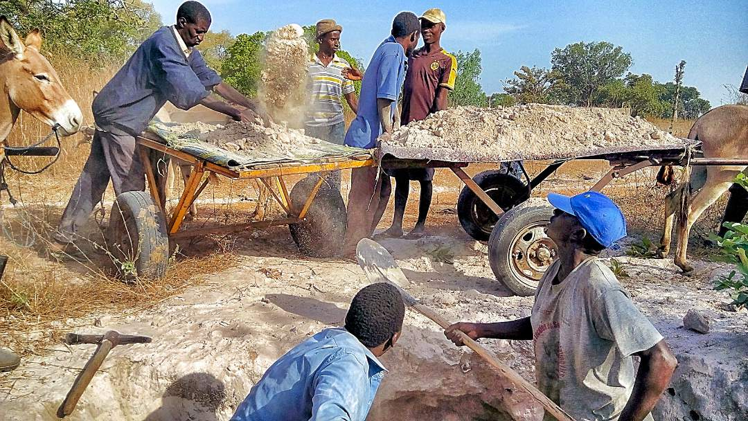 Workers building the well
