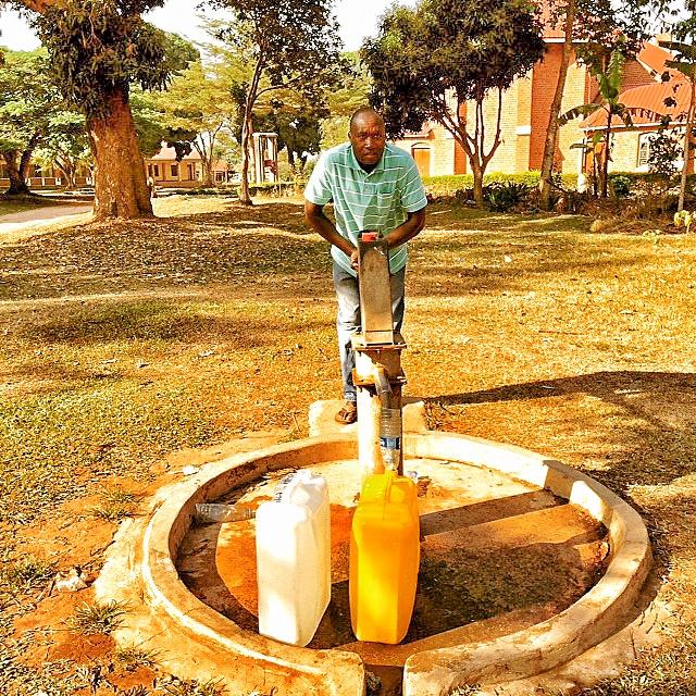 Man using manual pump