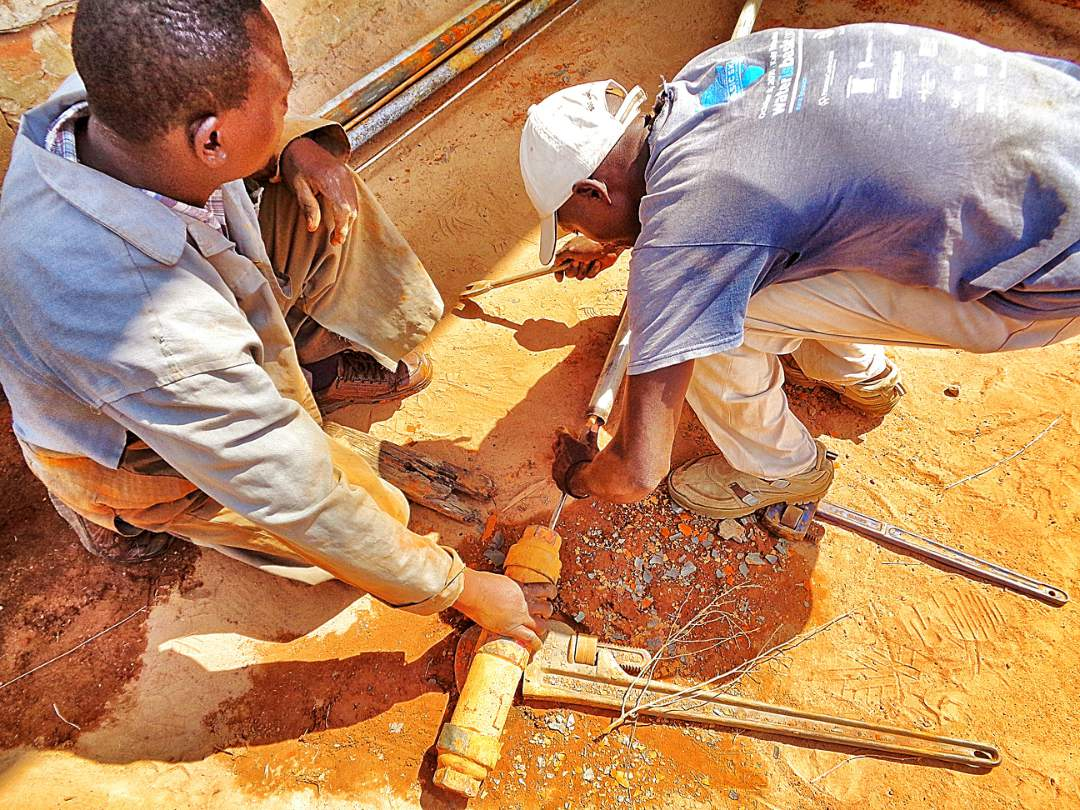 Workers rehabbing the well