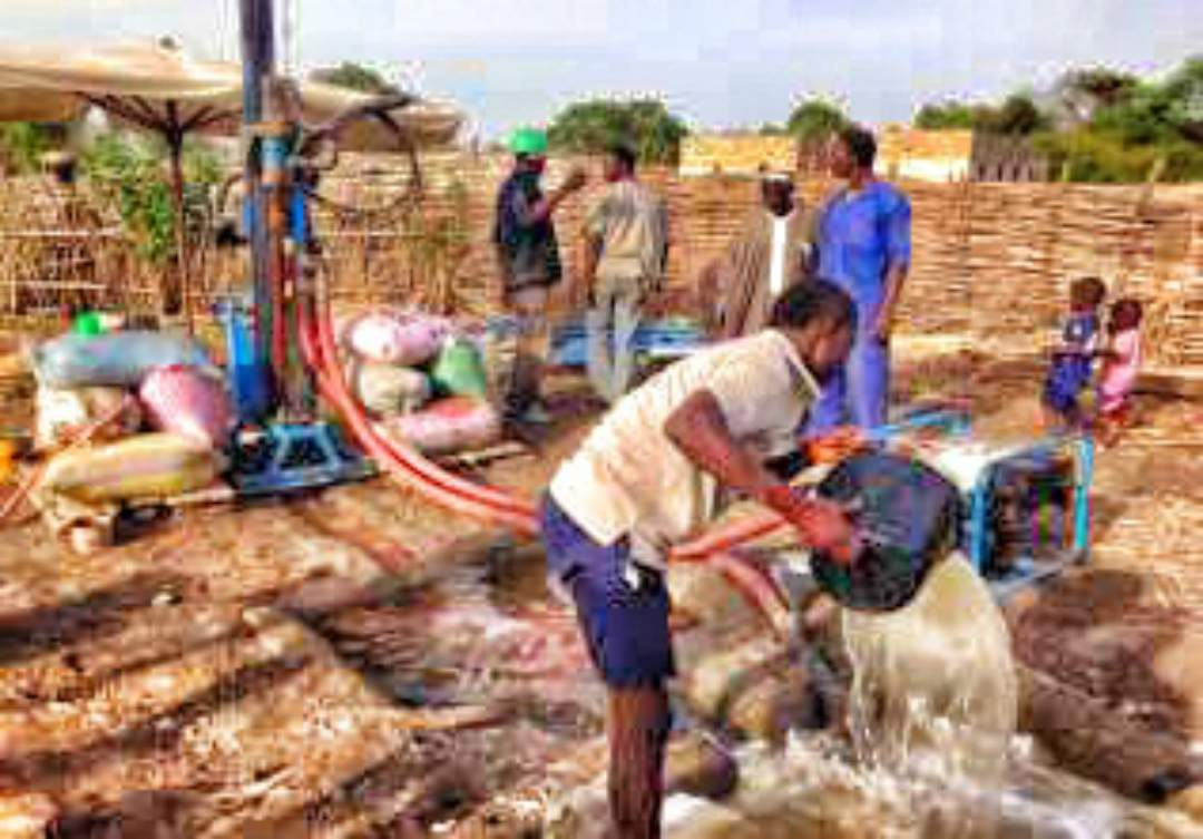 Villagers utilizing the well