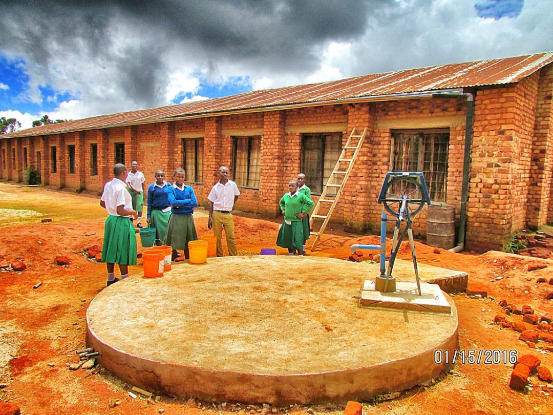Students at Hagati Secondary School near the well