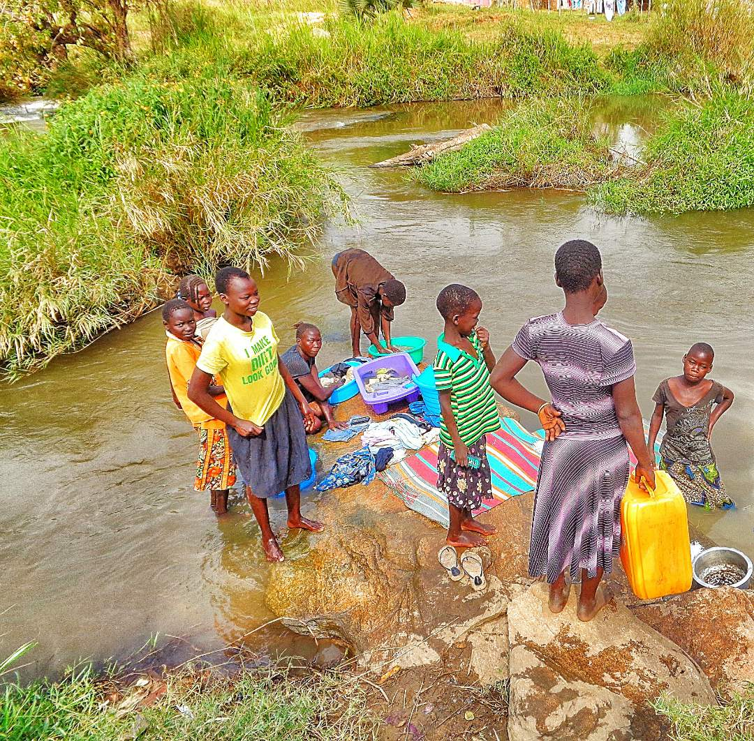 Mom and youth at the stream