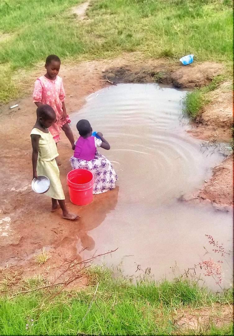 3 kids gathering water