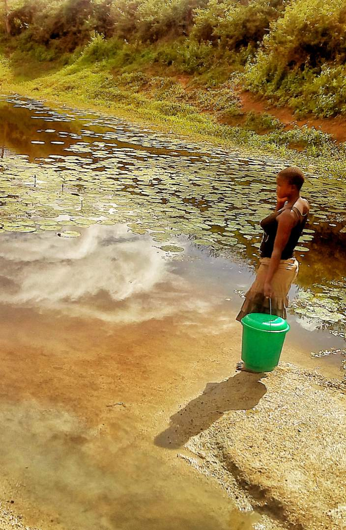 Woman collecting water