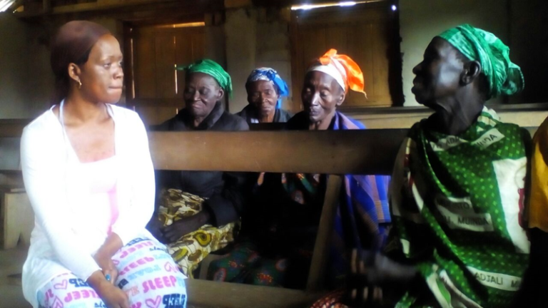 Neema with a widow in Ango