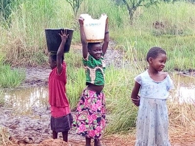 Kids fetching water at the refugee camp
