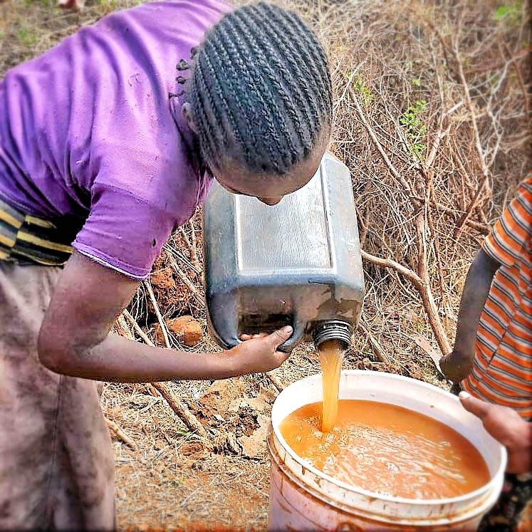 Girl Pouring Water - Simanjiro, Tanzania