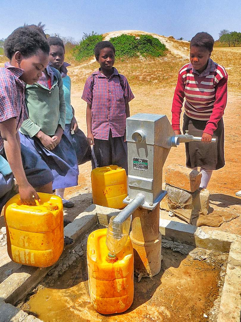 young boys at the borehole